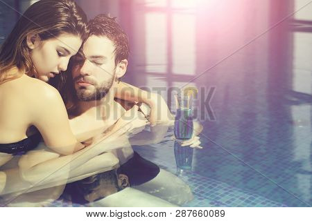 Wet Couple Of Pretty Woman Or Sexy Girl And Handsome Bearded Man Or Guy With Muscular Body In Swimmi