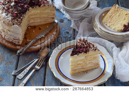 A Piece Of Delicious Coconut Layer Cake - A Biscuit And Cream On Coconut Cream, Decorated With Grate