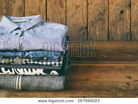 Teenager Casual Outfit. Boys Shoes, Clothing And Accessories On Wooden Background - Sweater, Shirt.