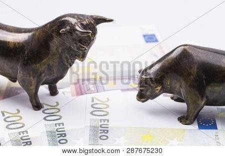 The Photo Shows A Bull And A Bear Standing On A Few Bank Notes