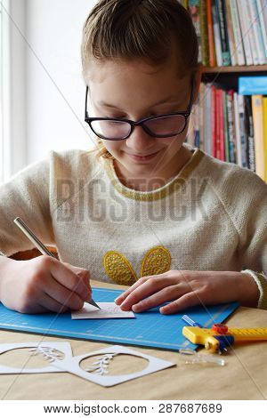 Girl Making Tunnelbook. 3D Greeting Card Spring . Artwork Equipment And Tools For Paper Cut - Knife,
