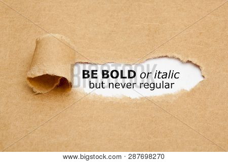 Inspirational Quote Be Bold Or Italic But Never Regular Appearing Behind Torn Paper. Concept About T