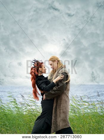 Fantasy Couple On The Beach Under The Clouds