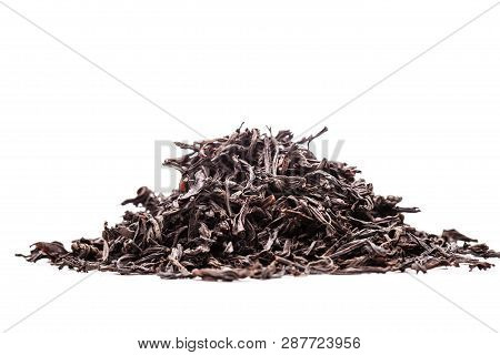 Pile Of Black Tea Leaves Against White Backgorund