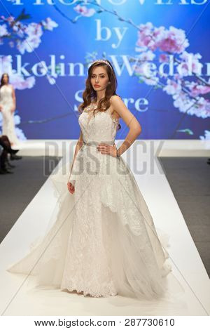 ZAGREB, CROATIA - FEBRUARY 02, 2019: Fashion model wearing beautiful wedding dress, on the catwalk of the Wedding fair show