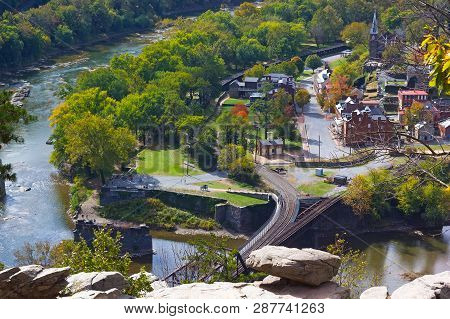 A View On Railroad Bridge Across The River At Harpers Ferry National Historic Park And Town. Early A