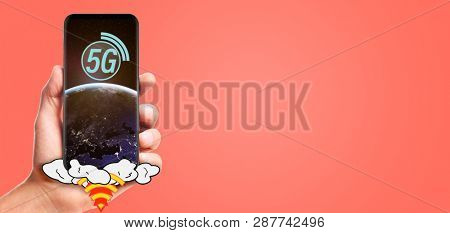 male hand hold launching 5G smartphone with planet Earth on screen, isolated on living coral background. Elements of this image furnished by NASA