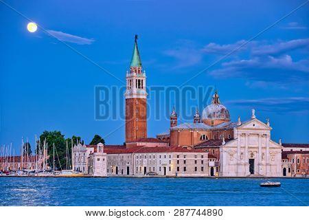 Basilica San Giorgio Maggiore Church seen across the Venice lagoon with full moon. Venice, Italy