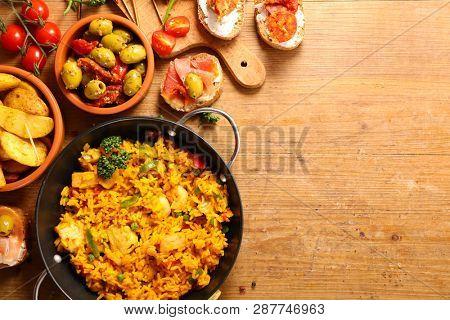 differents sort of spanish food. paella, tapas, potato,mussel