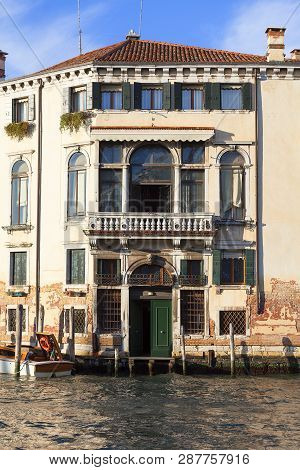 Grand Canal, Vintage Buildings, Parked Boats At The Marina, Venice, Italy. Canal Grande Is One Of Th
