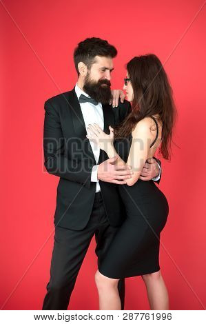 Elegance Is Not About Being Noticed. Award Ceremony Concept. Bearded Man Wear Suit Girl Elegant Dres