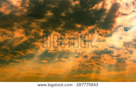God Light. Dramatic Dark Cloudy Sky With Sun Beam. Yellow Sun Rays Through Dark And White Clouds. Go