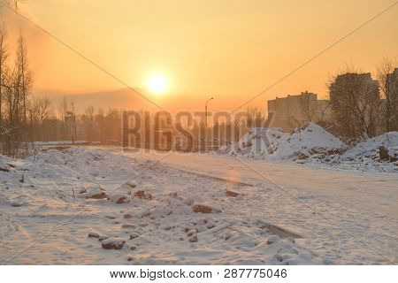 Road At Winter Sunset On The Outskirts Of St. Petersburg, Russia.