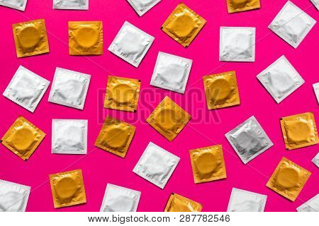 Condoms In Pink Background, Top View. Large Amount Of Condoms, Shot From Above - Safe Sex And Contra