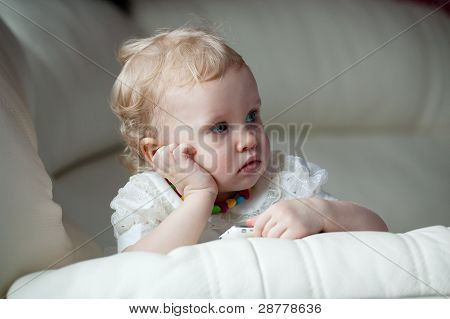Little Girl With A Phone In Thought Settled