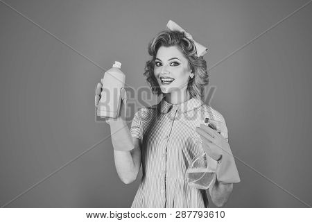 Retro woman cleaner on blue background. Pinup woman hold soup bottle. Cleaning, retro style, purity. Cleanup, cleaning services, wife, gender. Housekeeper in uniform with clean spray. poster