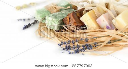 Handmade Soap With Natural Bast Washcloth And Lavender On A White Background . Natural Organic Soap