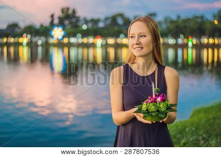 Young Woman Celebrates Loy Krathong, Runs On The Water. Loy Krathong Festival, People Buy Flowers An
