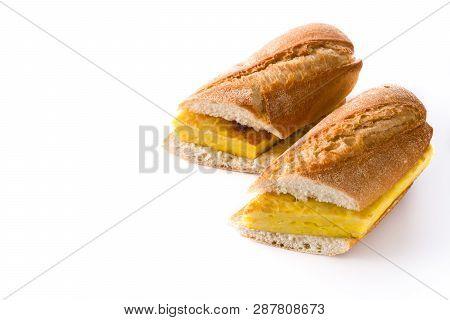 Bocadillo de tortilla española. Spanish potato omelette sandwich isolated on white background. Copyspace poster