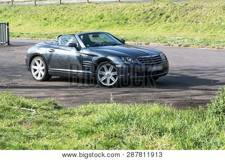 Mosel, Germany - March 26, 2016: Chrysler Crossfire Roadster In A Parking Lot In Germany On The Mose