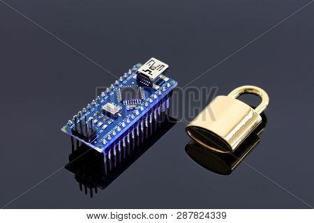 The Lock Near The Computer Chip Is The Concept Of Data Encryption, The Technology Of Encoding Operat