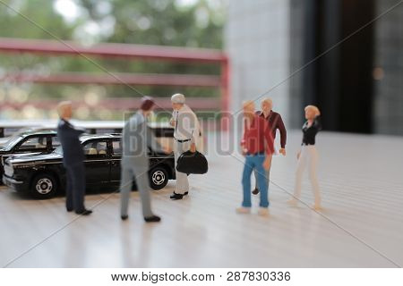 Small Figure Sit In The Toy Car