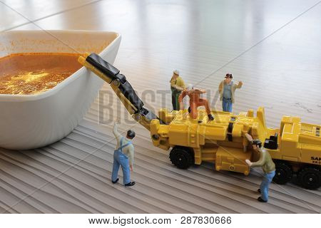 The  Miniature Of Figure Working On Bolognaise