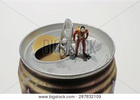 The Min Figure Divers Explore Soft Drink Cans