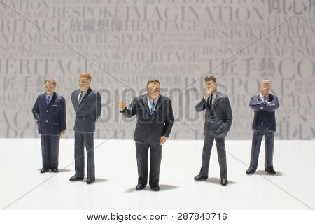 Small Figures Of Business Meeting