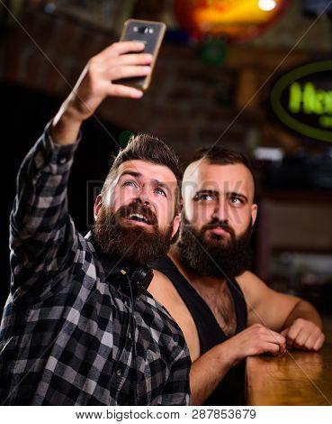 Online Communication. Man Bearded Hipster Hold Smartphone. Taking Selfie Concept. Send Selfie To Fri