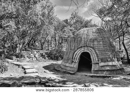 Pretoria, South Africa, July 31, 2018: A Replica Zulu Hut In The Forest At The Voortrekker Monument