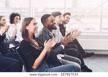 Business Education. Colleagues Clapping Hands At Seminar, Listening Speaker