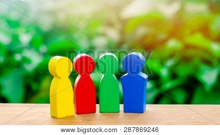 Four Colorful Figures Of People Talking. International Cooperation, Joint Project. The Concept Of Co