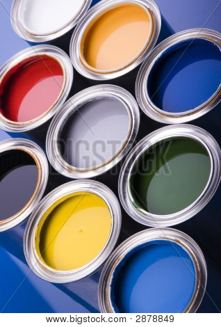 Cans And Paint On The Blue Background