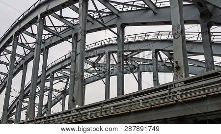 Poetry Of Metal Structures Of St. Petersburg. View Of American Bridges From The Sidewalk