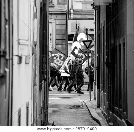 Strasbourg, France - Sep 12, 2017: View Through Tiny Street At Crowd With Flags - Political March Du