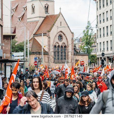 Strasbourg, France - Sep 12, 2017: Crowd With Paroisse Saint-nicolas Church As Political March Durin