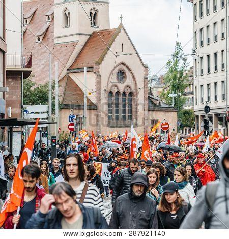 Strasbourg, France - Sep 12, 2017: Crowd With Paroisse Saint-nicolas Church As Political March Durin