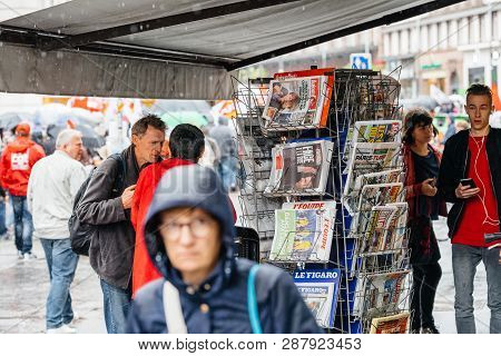 Strasbourg, France - Sep 12, 2017: Newspaper With Emmanuel Macron As Crowd Marching In Background Du