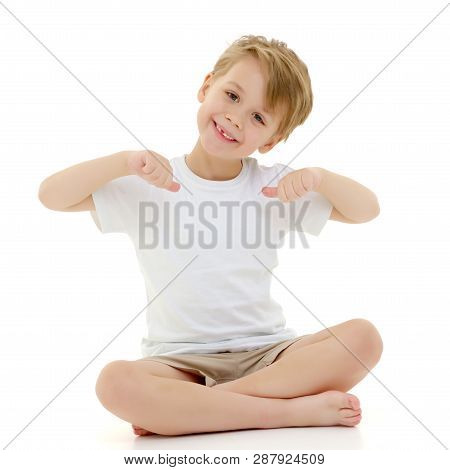 A Cute Little Boy In A Pure White T-shirt Points His Fingers At Her. On A T-shirt, You Can Make An A