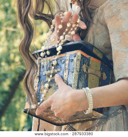 Old Treasure Chest In The Female Hands