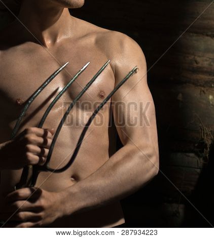 Torso Of A Male With A Pitchfork