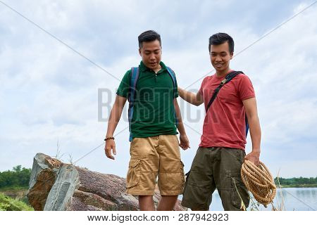 Outdoor Climbing Instructor Patting His Friend On Back After Difficult Exercise
