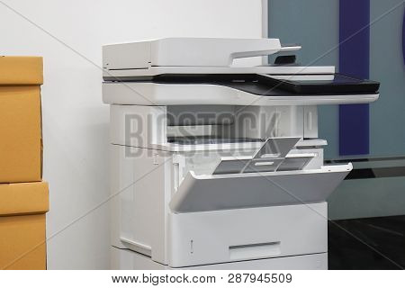 multifunctional office laser printer for use in scanning and printing documents in workplace poster