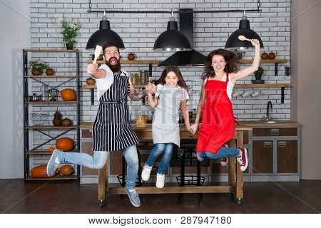 Weekend Breakfast. Cooking With Child Might Be Fun. Having Fun In Kitchen. Family Mom Dad And Little