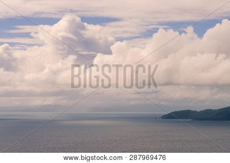 Clouds Over The Sea Horizon Nature Background. Clouds And Sea Landscape Background. Sea Nature In Su