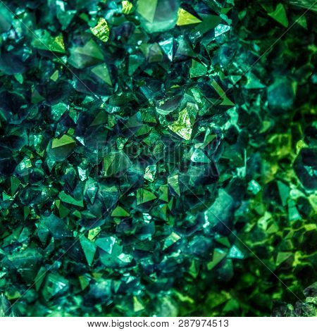 Emerald, Sapphire or Tourmaline green crystals. Gems. Mineral crystals in the natural environment. Stone of precious crystals on white background is insulated.