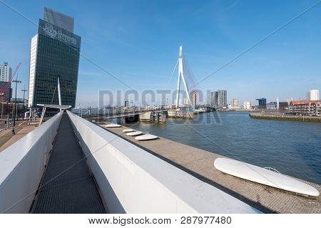 Rotterdam, Netherlands - March 26, 2016 : Erasmus Bridge And Kpn Tower Against Blue Sky And Sun