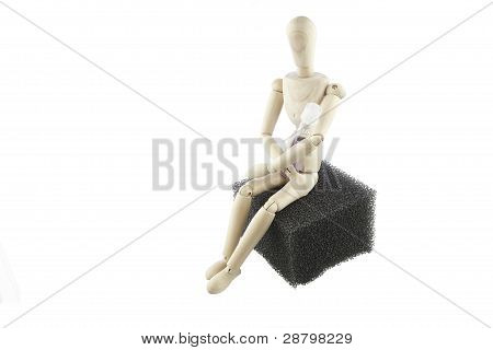 Wooden Man Sitting On Aquatic Filter Holding Test Vial poster