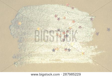 Golden glitter and glittering stars on abstract blue watercolor splash in vintage nostalgic colors. poster